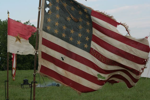 Flags fly at a re-enactment.