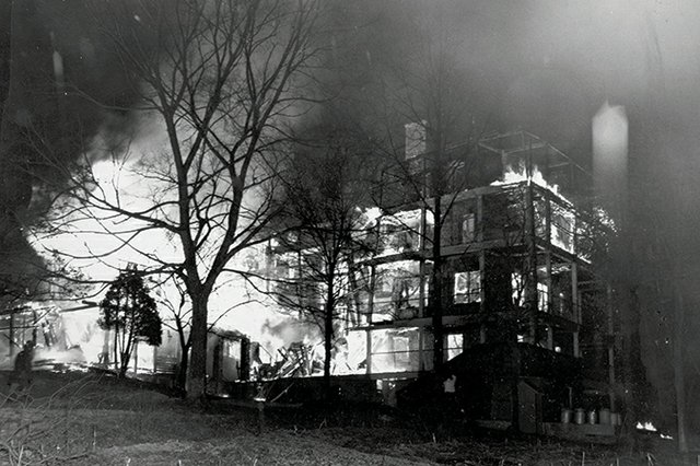 A black and white photo of the Central Building at Asheville's Highland Hospital on fire | Blue Ridge Country