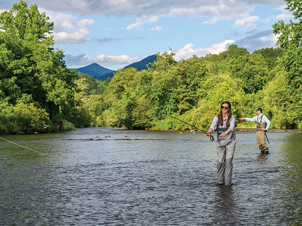WNC-Fly-Fishing-with-Woman-in-Daytime.jpg
