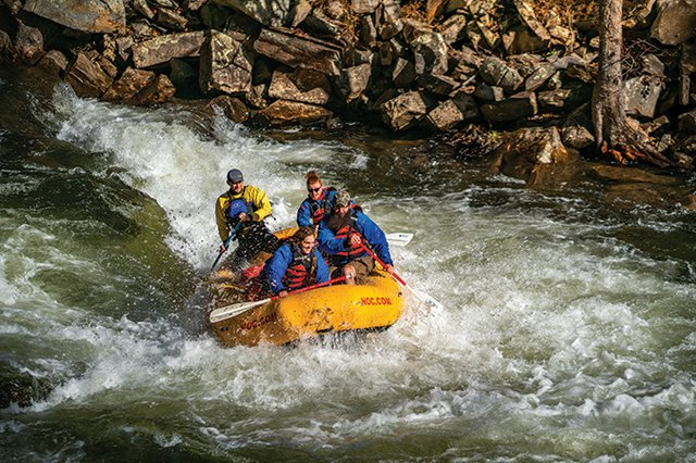 Whitewater-Rafting-at-Nantahala-Outdoor-Center-With-Rocks-In-Background.jpg