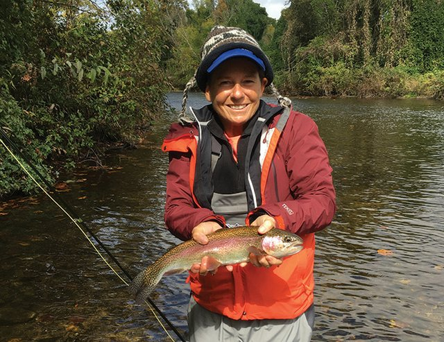 Dale-Wilde-fishing-for---and-catching---trout-in-a-mountain-stream.jpg